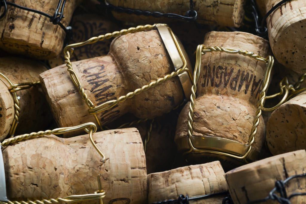 Stack of leftover Champagne corks with wire cage