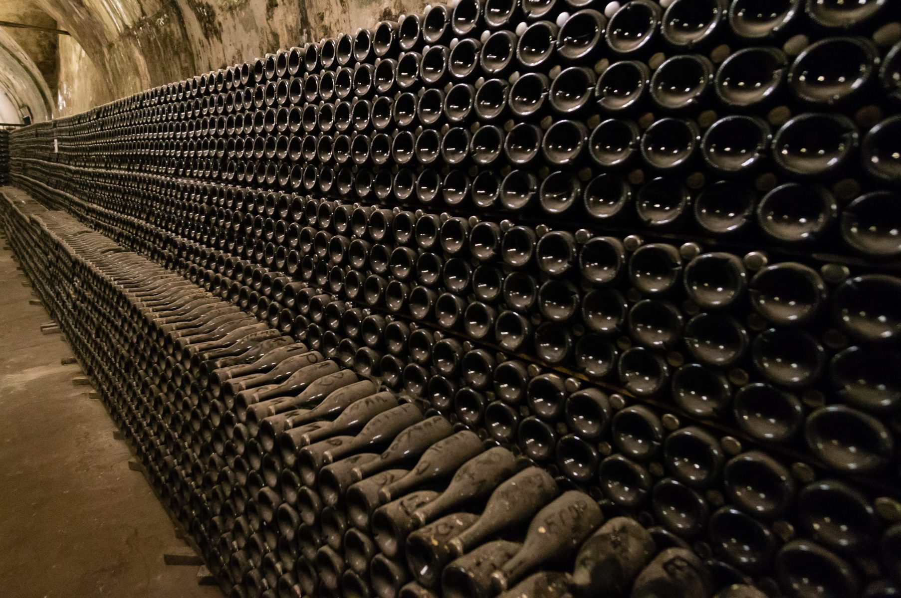Champagne bottles stacked in cellar for lees aging